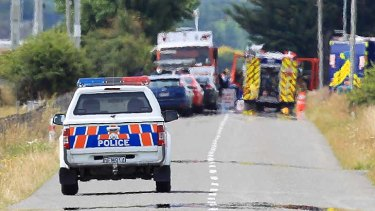 A police vehicle drives through the cordon heading to the accident site.