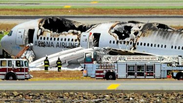 An Asiana Airlines Boeing 777 is seen on the runway at San Francisco International Airport after crash landing.