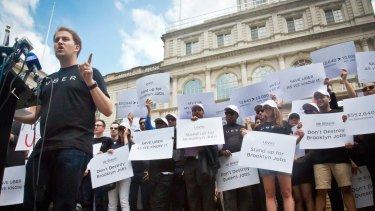 Grass roots? Not so. Josh Mohrer, left, Uber's general manager in New York, at a rally outside City Hall in June.