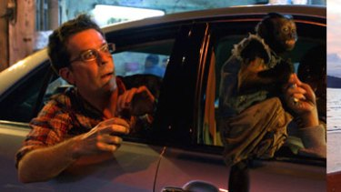 Above left: The Hangover Part II's Ed Helms in the car chase scene; (right)  Scott McLean, the stuntman for Helms.