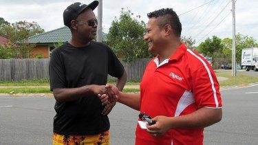 Indigenous community leader Paul Butterworth shakes the hand of Samoan Wesleyan Methodist Church pastor Moe Fonoti.