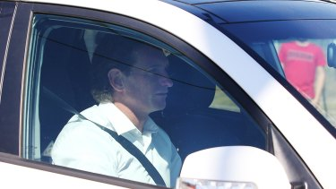 James Hird arrives at the club's headquarters after the verdict on Tuesday.