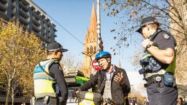 Police begin jaywalking crackdown by giving elderly woman a