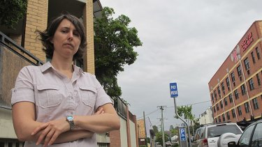 Teneriffe resident Gillian Carter wants to know why a building twice the allowable height has been approved for the area. The complex would tower nine metres over the woolstores building, currently home to the Nova radio station, at right.