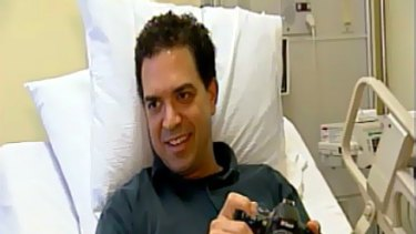 Dan Woolley, with his trusty digital SLR camera, recovers in hospital.