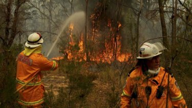 Firefighting strike teams converge on Bells Line of Road fires near Mount Victoria west of Sydney on Sunday.