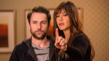 Bossy boots: Dr Julia Harris (Jennifer Aniston) lays down the law to Dale (Charlie Day) in <i>Horrible Bosses 2</i>.