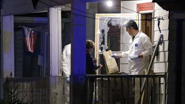 Investigation: members of the FBI evidence team remove items from the house.