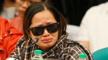"""A pregnant witness, the live-in partner of JP Bertes, an alleged drug-pusher who was killed while in police custody, tearfully recounts their ordeal as she testifies before the Philippine Senate which is probing the extra judicial killings related to President Rodrigo Duterte's """"War on Drugs""""."""