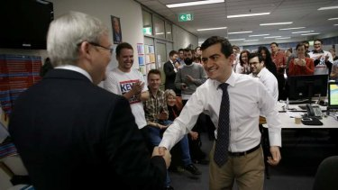Prime Minister Kevin Rudd is greeted by NSW ALP party secretary Sam Dastyari at ALP campaign headquarters in Melbourne.