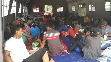 The members of the Gafatar sect, seen here at a temporary evacuation camp, insist they are observant Muslims.