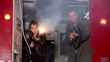 Emilia Clarke is Sarah Connor and Jai Courtney is Kyle Reese in <i>Terminator Genisys</i>.