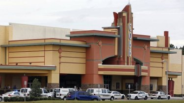 Police vehicles parked outside the cinema  in Wesley Chapel, Florida, where a man was shot dead after an argument about texting.