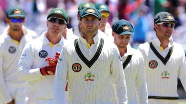 Long faces after one of the shortest Test innings on record ... captain Michael Clarke leads his Australian team from the field at Newlands, Cape town, after its humiliating defeat to South Africa.