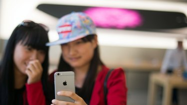 Checking out an iPhone 6 in an Apple store in Shanghai.