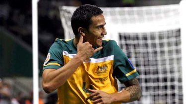 Australia's Tim Cahill celebrates after scoring his team's fourth goal against India.