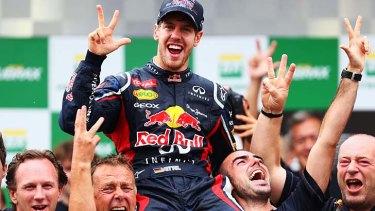 Sebastian Vettel celebrates on the podium.