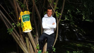 Thomas Voeckler poses with his jersey near a waterfall in Valence, southern France, on the second rest day of the Tour.