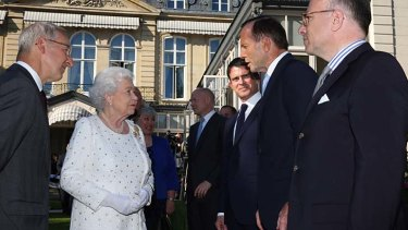 Prime Minister Tony Abbott meets Queen Elizabeth II at an exclusive party on the eve of D-Day commemorations in France.