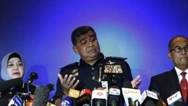 Malaysia's police chief, Inspector General Khalid Abu Bakar, speaks at a news conference at the Kuala Lumpur International Airport.