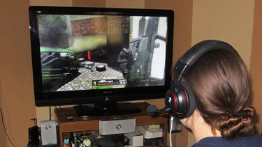 A girl uses an Xbox to play a game.