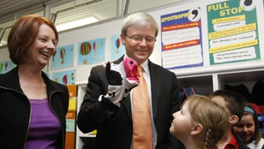 Julia Gillard and Kevin Rudd visit the Amaroo School in Canberra yesterday.