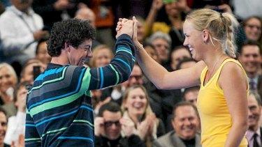 Perfect match: Golfer Rory McIlroy with fiancee, tennis player Caroline Wozniacki.