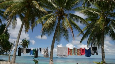 Laundry hangs on the edge of a lagoon, near Funafuti, Tuvalu. Pacific Island nations called for the Paris climate agreement to be legally binding.