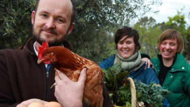 CERES' Chris Ennis, holding Hazel the chook, with Dori Ellington and Cinnamon Evans.