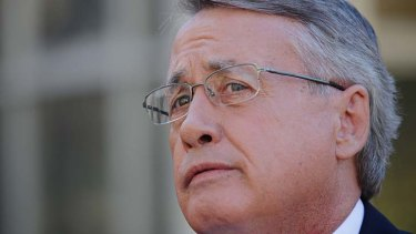"""It's not about them or us, it's about the country"": Treasurer Wayne Swan."