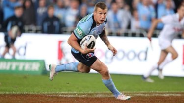 Match-winner: Trent Hodkinson beats the Maroons defenders to dive over for NSW.