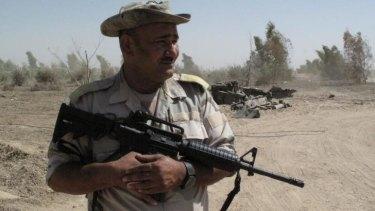 Kurdish Peshmerga fighter on the frontline near Makhmur.