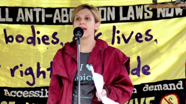 Cait Calcutt from Children by Choice addresses the rally for abortion rights at Queens Park, Brisbane.