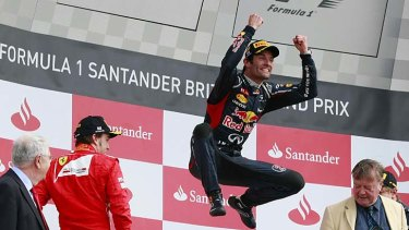 Jumping for joy ... Mark Webber celebrates after winning the British Grand Prix at Silverstone.