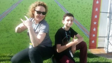 Triple j DJ Zan Rowe handed over to Canberra year six student Rhys Toms at Sunday's Groovin the Moo.