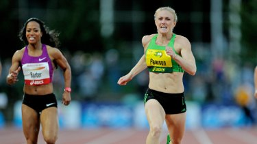 In front: Sally Pearson (right) storms to victory over Mikele Barber in the 200metres last night.