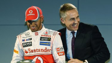 Lewis Hamilton jokes with McLaren team leader Martin Whitmarsh during the launch of the McLaren Mercedes Formula One car for the 2012 season in Woking, England. A Munich court wanted Hamilton to give evidence in Adrian Sutil's trial.