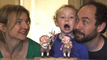 Janette Goodey and John Lewis with their daughter, who labelled their Percival Pilts character ''the funny man''.