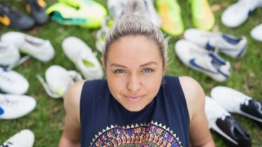 Matildas star Kyah Simon and some of her soccer boots collected over the years.