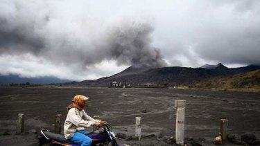 A motorist passes near Mount Bromo in Probolinggo, East Java.