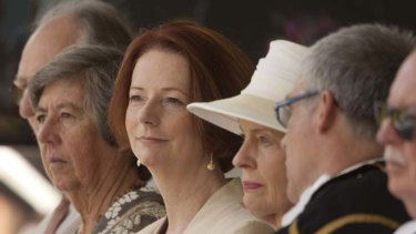 Holding out … Julia Gillard sits beside the Governor-General, Quentin Bryce, at the 70th anniversary of Japan's attack on Darwin. Photo: Glenn Campbell