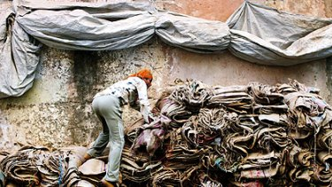 A rag trade worker in Jodhpur where they work for a minimum wage and suffer with health issues usually resulting in early death.