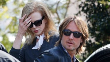 Nicole Kidman and her husband Keith Urban arrive at her parents' house in Sydney.