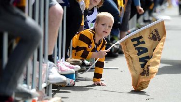 A young Hawk supporter at the annual grand final parade through the streets of Melbourne.