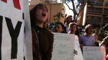 Protestors at Julia Gillard's climate change announcement in Brisbane today.