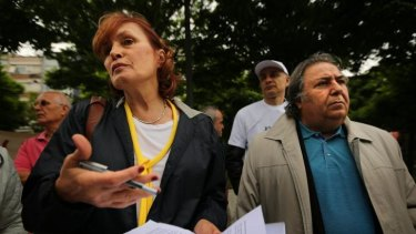 "Irem Kutluk (left), the wife of detained Turkish admiral Ali Deniz Kutluk, demands justice for her husband and other officers imprisoned over the ""Sledgehammer"" plot in Besiktas Square, Istanbul, on May 31."