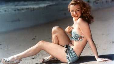 Athletic ... Marilyn Monroe posing on the beach in 1949, photographer unknown.