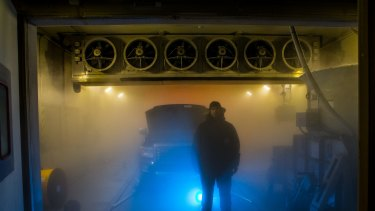 Emissions Contoller Robert Acs works in a testing bay at minus 30 degrees at Holden's Lang Lang facility