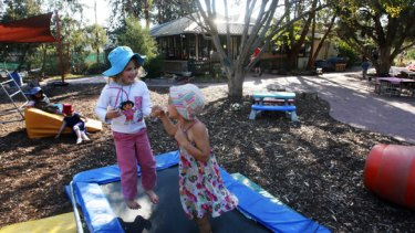 """Children at play at the  Lady Forster Kindergarten in Port Melbourne, which the City of Port Phillip wants to demolish and incorporate into an """"early childhood hub""""."""