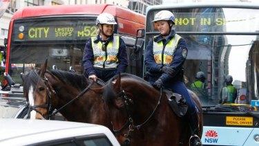 Operation Hammerhead is go: Mounted police patrol Sydney CBD during morning rush hour .